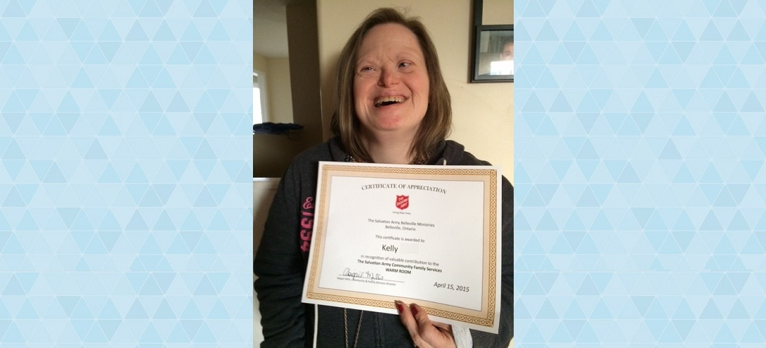 Smiling woman with certificate
